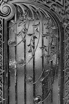 The wrought iron door B&W, seen in Paris (2009). photo via jmvnoos on flickr