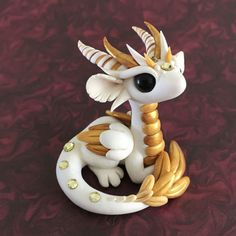 Golden-Angel-Dragon-Sculpture-by-Dragons-and-Beasties