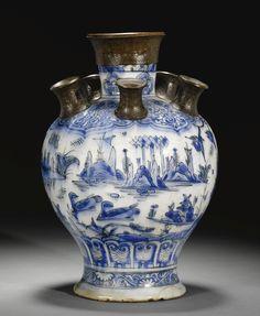 A SAFAVID BLUE AND WHITE POTTERY TULIP VASE, PERSIA, 17TH CENTURY