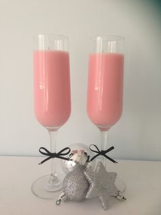Champagne flutes filled with soy wax in champagne and strawberries fragrance
