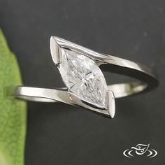 Custom Palladium Half wrap mounting with Marquise center stone set at a tilt. Engraved on 1 side scroll engraving 9-12 o'clock position. Size 5.5 Polish finish - See more at: http://www.greenlakejewelry.com/gallery/cust_gallery.aspx?ImageID=65252#sthash.YzhkXBju.dpuf