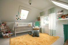 Yellow and turquoise accent for nursery. White furniture with toupee walls.