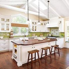 How wonderful. Love the natural light and vaulted ceiling.   white cabinets.  kitchen.  home decor and interior decorating ideas.  lake home.