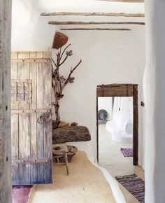 Beautiful organic white walls and rustic wood details.