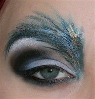 unique way to incorporate an eyebrow into a makeup design. i can see this look as a peacock costume enhancement.