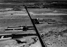Highway 91 looking North along the Las Vegas Strip. This was pre Rat Pack and back then just a two lane highway. The Flamingo is at the top right. South of there are seen three motels at what is now the intersection of Las Vegas Blvd and Tropicana Avenue. The Dunes construction is underway at the top left and at the lower right a billboard for The Sands. (1954)