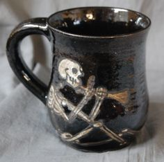 I like this cheery Skeleton musician on this cup