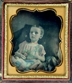ca. 1840's, post mortem daguerreotype portrait of a young girl who seems to have died of a wasting disease.