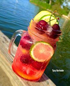 NATURES FINEST 1 oz (30 ml) Cherry Vodka  1/2 oz (15 ml) Seagrams Twisted Lime Gin 1/2 oz (15 ml) Tuaca Liqueur  Fresh sliced Lemon & Limes  Fresh Cherries 1/4 oz (7 ml) Lime Juice  1/4 oz (7 ml) Maraschino Cherry Juice  Top off with Lemon Lime Soda