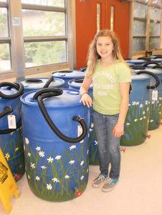 Daisies painted on rain barrels