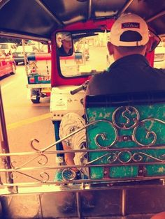 Riding on the fast-speeding-crazy-short-cutting Tuk Tuk at Bangkok, Thailand