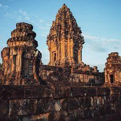 Beautiful rays of light strike Angkor Wat shortly after sunrise... Siem Reap, Cambodia  #Regram via @whyweseek