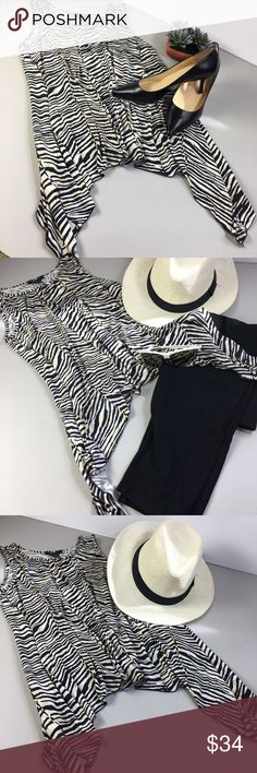 Robert Louis Animal 🦓 Print Traveler Tunic Great traveling tunic, perfect for leggings or jeggings.  This is a Statement top. Be bold, be brave. 🦓🦓 Robert Louis Tops Tunics