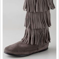 Grey 3 layer fringe Minnetonka boots These are grey three layer fringe Minnetonka boots. They have only been worn one time Minnetonka Shoes Moccasins