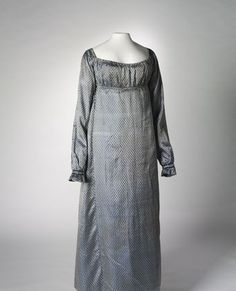 1810-1813 Dress, silver and blue shot silk with dark blue flower pattern
