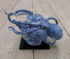 http://www.thisiscolossal.com/2017/06/octopi-embedded-in-ceramic-vessels-by-keiko-masumoto/?src=footer
