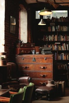 Your home is not a home if you dont have a space devoted entirely to books! This room has been decorated with very good taste! I ❤ the typewriter and the lighting!!!