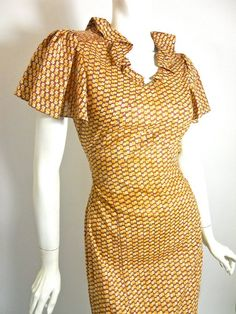 30s feather light, summery crisp cotton bias cut dress in a terracotta and maize deco abstract floral print.