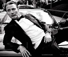 Hot Mads posing on a car