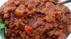 Ground beef, Italian sausage, beans, and a tomato base come together with lots of flavor and spice in this popular chili recipe. It's perfect for tailgating before football games or any time of year. Kale Recipes, Chili Recipes, Soup Recipes, Cooking Recipes, Cooking Chili, Dinner Recipes, Crockpot Recipes, Cooking Turkey, Gourmet