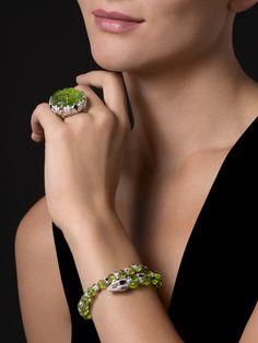 "CARTIER. ""Green Anaconda"" Ring - white gold, one 47.66-carat carved peridot, orange sapphires, onyx, brilliant-cut diamonds. ""Green Anaconda"" Bracelet - white gold, melon-cut peridots, orange sapphires, onyx, emerald eyes, brilliant-cut diamonds. #Cartier #CartierMagicien #2016 #HauteJoaillerie #FineJewelry #Peridot #OrangeSapphire #Onyx #Diamond"