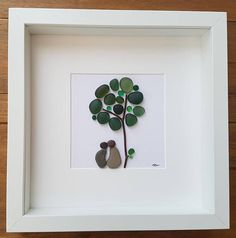 A beautiful and unique handmade beach pebble picture of couple sitting under a sea glass green apple tree. This picture would compliment any room and would make a perfect gift. The picture is made using pebbles, wood, sea glass and thin jewellery wire. All materials are carefully placed