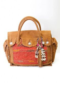 This bag is stupid expensive but if it was in a corner of a thrift shop I would swoop it up! (simone camille)