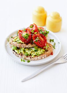 This delicious healthy breakfast, lunch or snack couldn't be easier to put together. Ripe tomatoes, avocado and salad leaves on toast are a great vegetarian combination.