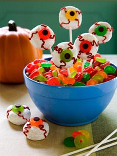 Spooky Edible Eyeball #Recipe You will need:    (12) small white powdered sugar doughnuts    (1) tube red icing    (1) 7 oz. bag Life Savers Gummies    (1) bag chocolate chips