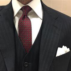 Paisley skinny tie and black three piece suit.