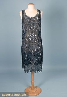 SILVER BEADED PARTY DRESS, 1920s Black silk chiffon w/ 3 sizes silver beads & scattered rhinestones in stylized geometric & floral pattern