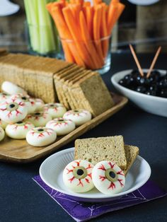 Who knew creamy mini cheeses, olives and a little food coloring could look so creepy yet taste so yummy?! Fill up your party guests with these savory little mouthfuls for a fun take on standard cheese and crackers.