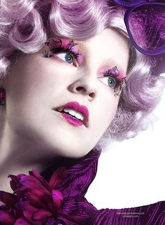 Effie Trinket. She's most definitely going to be my favorite character in this movie just because her costuming and makeup is so damn cool.