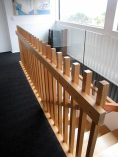 This modern Victorian Ash stair floats off the concrete block feature wall using a hidden steel support structure.