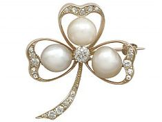 A stunning antique Victorian pearl and 1.05 carat diamond, 14 carat yellow gold brooch in the form of a 'clover'; part of our diverse antique jewellery and estate jewelry collections