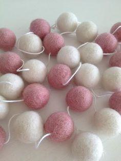 http://mylittlelovebird.co.nz/shop/felt-ball-garland-pink-white/
