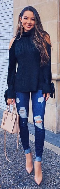 #winter #outfits black cold-shoulder sweater and blue distressed jeans