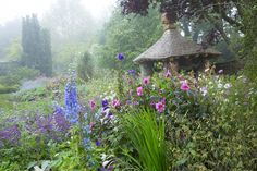 Peaceful: The Cottage Garden is packed with traditional perennials and includes Prince Charles' summer house