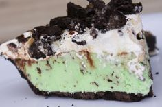 Grasshopper Ice Cream Pie~ oreo crust, mint chocolate chip ice cream, cool whip, caramel, and hot fudge sauce, add oreos on top.