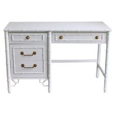 "This vintage Thomasville white faux bamboo desk has recently been painted a lovely high-gloss white. It comes with the original brass hardware and handles in the shape of bamboo. A really wonderful desk!  Dimensions: 30"" high X 46"" wide X 19"" deep Kneehole is 23 1/2"" high"