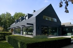 WillemsenU Architecten has remodelled a house near Eindhoven, adding a new dark cladding to the exterior and reorganising the rooms inside 1960s House Renovation, Renovation Facade, Modern Barn, Modern Farmhouse, Norwegian House, Dutch House, Timber Cladding, House Cladding, Modern Mansion