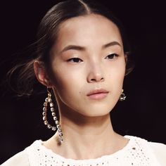 Nina Ricci's Consciously Coupled Mismatched Earrings #2015 into Spring #2016 #jewelry trend