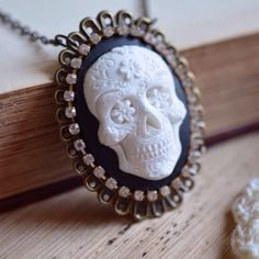 Sugar Skull Cameo Necklace This gorgeous sugar skull/day of the dead cameo necklace is up for grabs in my closet! Cameo is made from perfectly sculpted polymer clay. The details in the skull are beautiful! Cameo is mounted to a bronze filigree frame that has sparkly rhinestones wrapped around it. Chain is nickel & lead free. Handmade/Brand New. If you have any questions feel free to ask. Bundle & save 15% on 3+ items! Abbie's Anchor Jewelry Necklaces