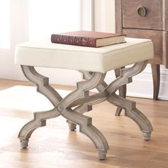 "Collections  >  Furniture > Seating > Stools & Ottomans  X-Base Stool - Cream  ITEM NUMBER W2387 $299  Dimensions: 20.5""w x 18""d x 19""h"