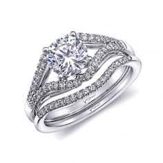 This unique engagement ring features a 1CT center stone framed by a beautifully tailored split shank encrusted in diamonds. (LC6009) #coastdiamond