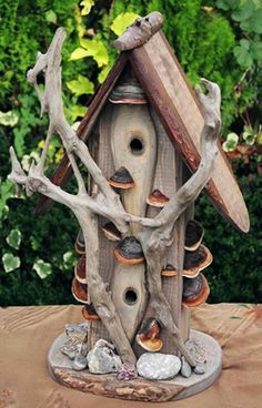 drift wood fairy home-they will share it with the birds though!  Bird house