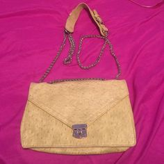 Soft yellow bag Soft yellow Faux ostrich textured bag. With gold chain detail and 3 side pockets and a zipper pocket located on the inside Bags