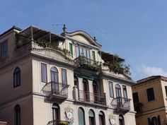 """Venetian houses, reaching up from the """"street"""" level."""