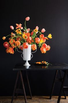 A mix of dramatic parrot tulips and the larger French variety in peaches, yellows, and corals will always be a crowd-pleaser.