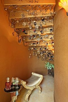 Put the area under the stairs to good use with with a hidden wine retreat.